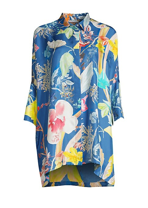 Image of Crafted in rich silk twill, this poncho-sleeve blouse is finished with dreamy florals and a minimalist long-line silhouette. Point collar. Three-quarter length cape sleeves. Front covered button close. Vented hem. Silk. Dry clean. Made in Italy. SIZE & FI