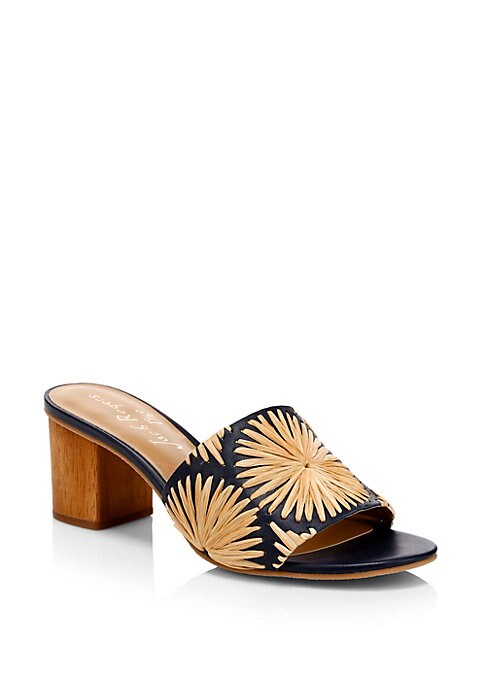 Chic raffia mules with a pretty floral design. Raffia/straw upper Slip-on style Open toe Leather sole Imported SIZE & FIT Heel, 2\