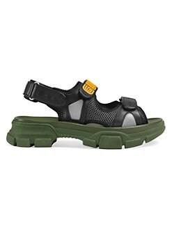 36bd5225cff Gucci. Leather   Rubber Logo Strap Sandals