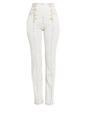 Image of Balmain's signature button finish lends itself to these high-rise pinstripe jeans. Their slim fit and seamed finish make them a sartorial jean that glimmers with goldtone accents. Seamless waistband Front button finish Side slip pockets Back slip pockets