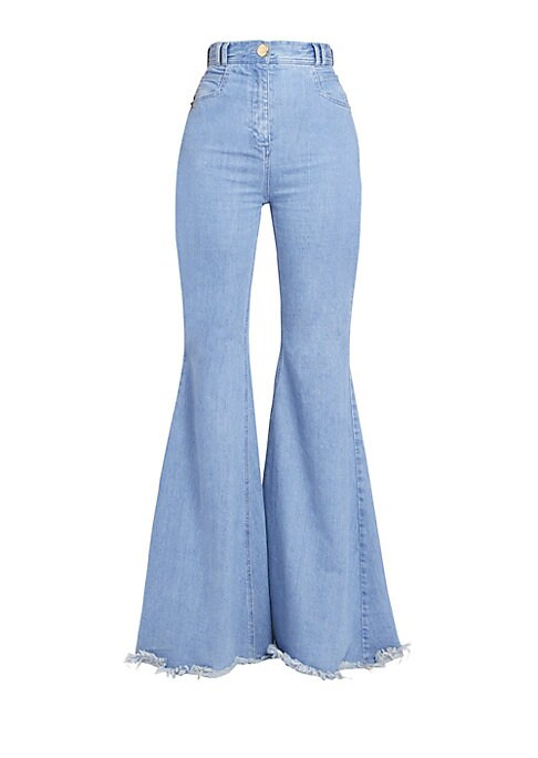 Image of Make a statement in these retro-inspired jeans with eye-catching wide-leg silhouette. Made in Italy of stretch cotton, these jeans boast a frayed hemline for a look that's right on-trend. Belt loops. Five pocket style. Zip fly with button closure. Back pa