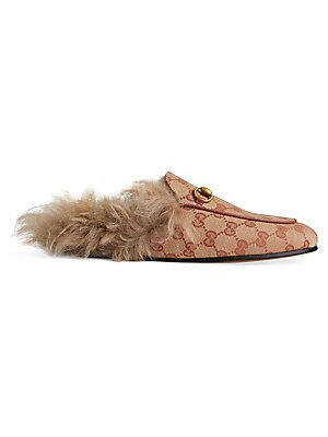 "Image of Heel height, 0.5"" (13mm) Original GG canvas upper Moccasin toe Slip-on style Lamb wool lining Leather sole Fur type: Dyed lamb Fur origin: Italy Made in Italy. Women's Shoes - Gucci Womens Shoes. Gucci. Size: 35 (5)."