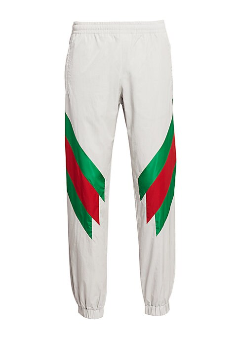 """Image of Elastic waistband with hidden drawstring. Front zip pockets. Elastic detail at the leg opening. Loose fit. Technical nylon with web intarsia. Rise, about 9"""".Inseam, about 36"""".Leg opening, about 14"""".Polyamide. Dry clean. Made in Italy."""