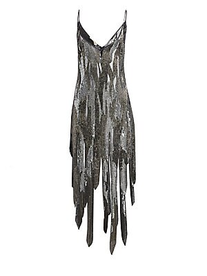 Image of Peek-a-boo mesh panels break up the sequin finish on this dress fit for a modern flapper. Wide fringes make up the skirt, imbuing the frock with plenty of movement. V-neck Spaghetti straps Pullover style V-back Asymmetric high-low hem Viscose Dry clean Im
