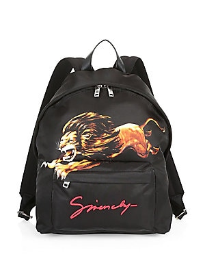 Image of A bold lion graphic refreshes this classic backpack with a luxe satin finish. Top handle Adjustable backpack straps Zip-around closure Silvertone hardware One outside zip pocket One inside zip pocket Front logo embroidery Lined Polyamide Imported SIZE 12W