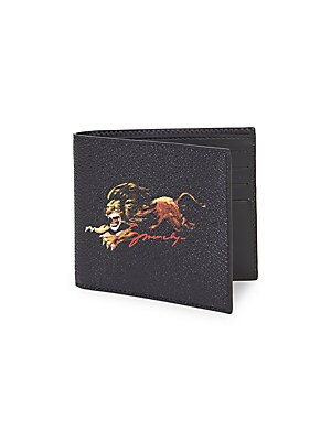 "Image of Illustrated lion fronts textured bifold wallet. Interior bill slot Eight interior card slots Cotton/polyurethane/polyester Imported SIZE 4.5""W x 4""H. Men Accessories - Leather Goods > Saks Fifth Avenue. Givenchy."