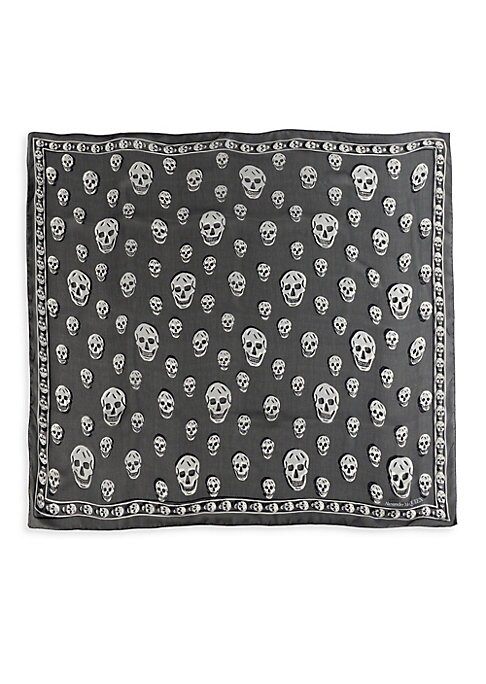 """Image of Allover signature skulls adorn this reversible luxe silk scarf. Silk. Dry clean. Made in Italy. SIZE.41""""W x 47""""L."""