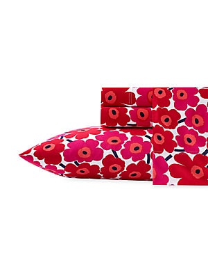 Image of From the Unikko Collection. This pattern is a true classic and part of Marimekko's first floral collection designed in 1964. Due to its perennial popularity over the years, it has become synonymous with the brand. The design has been produced in many diff