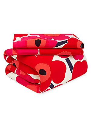 Image of This pattern is a true classic and part of Marimekko's first floral collection designed in 1964. Due to its perennial popularity over the years, it has become synonymous with the brand. The design has been produced in many different colors, but by far the