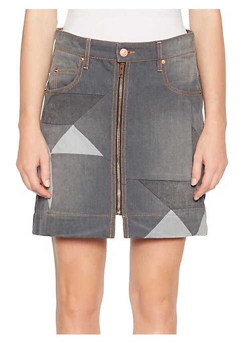 Image of From the Saks It List: The Mini Skirt. Triangular patches lend an abstract quilted design to this edgy denim skirt. Belt loops. Five-pocket style. Zip front with button closure. Exposed stitching. Cotton. Dry clean. Imported. SIZE & FIT.A-line silhouette.