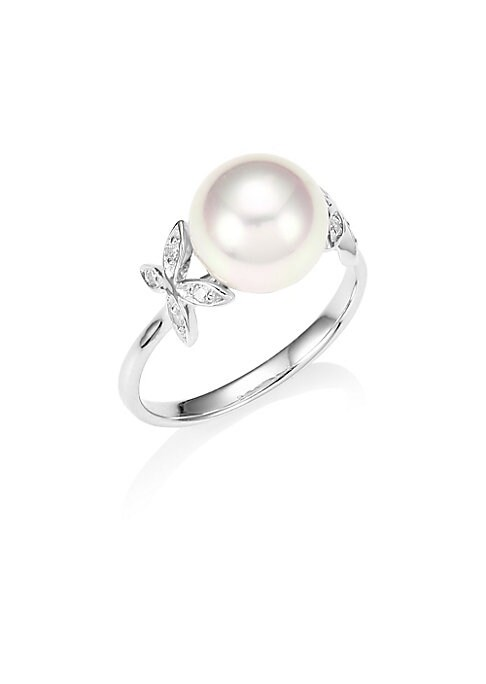 Image of A luminous pearl centers this deilicate silver ring finished with crystal butterfly accents. White round pearl, 9mm. Cubic zirconia. Silver. Made in Spain.