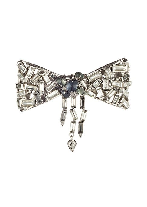 """Image of Brilliant baguette crystals cover bow-shaped pin. Green tourmaline. Pyrite. Hematite. Crystal. Silvertone. Pin back. Made in USA. SIZE.2.6""""W x 2.2""""L."""