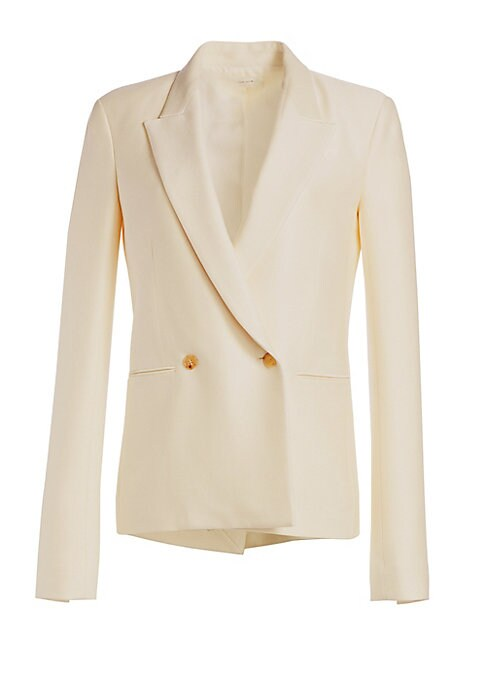 Image of Sharp peak lapels lend a structural aesthetic to this sleek virgin wool and silk jacket. Flaunting a relaxed silhouette and elongated sleeves, this is a contemporary interpretation on the boyfriend jacket. Peak lapels. Long sleeves. Buttoned cuffs. Double