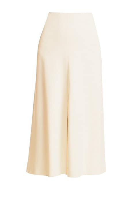 Image of An elegant A-line midi skirt is defined by minimal luxe styling. The high-waist silhouette skims your curves while the fluid skirt adds light-as-air movement. Concealed back zip. Silk lining. Viscose/elastane. Dry clean. Made in USA. SIZE & FIT. About 30""