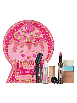Image of $61 VALUE WHAT IT IS Satisfy all your beauty cravings! Get irresistible in an instant with this complete makeup kit for brows, face, lips & lashes! Includes Benefit's cult-favorite gimme brow+ volumizing fiber gel for fuller-looking brows in an instant, i