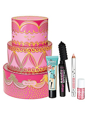 Image of $89 VALUE WHAT IT IS Piece-of-cake pretty! 4 Benefit bestsellers in 1 cake-inspired tin what a delicious indulgence! Get a full-size of Benefit's BADgal BANG! Volumizing Mascara, iconic the POREfessional Pore-Minimizing Face Primer, High Brow Highlight &