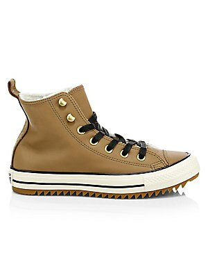Image of A classic high-top warmed by faux shearling lining. Leather upper Lace-up style with metal eyelets Pull-tab at heel Fleece textile lining Padded insole Vulcanized rubber sidewall with contrasting trim Gum rubber outsole with aggressive tread Fur type: fau