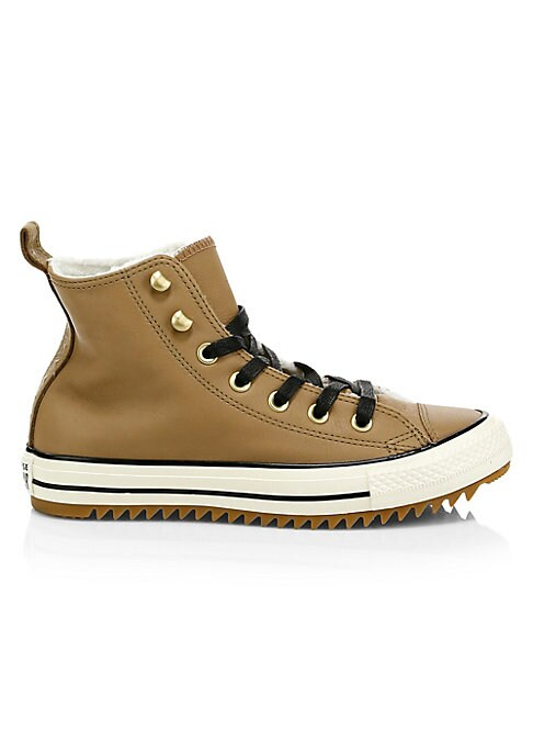 Image of A classic high-top warmed by faux shearling lining. Leather upper. Lace-up style with metal eyelets. Pull-tab at heel. Fleece textile lining. Padded insole. Vulcanized rubber sidewall with contrasting trim. Gum rubber outsole with aggressive tread. Import
