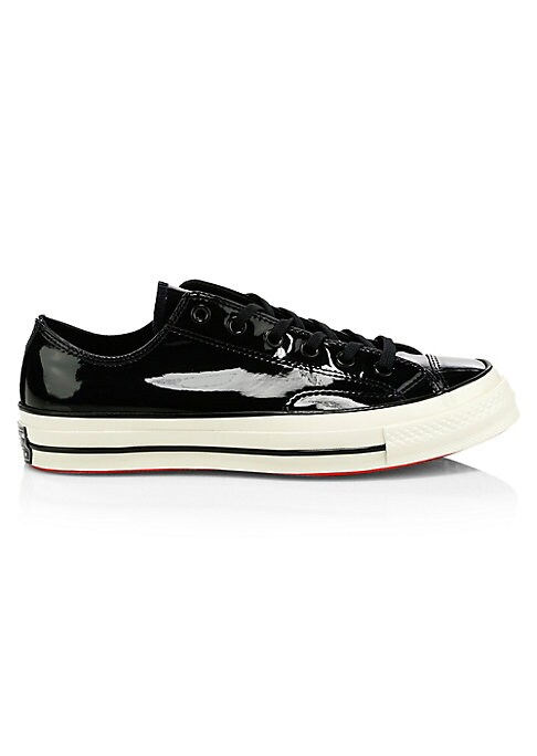 """Image of Liquid-like patent upper updates classic 70's-designed sneakers. Patent leather upper. Lace-up vamp. Round toe. Padded insole. Leather lining. Rubber sole. Imported. SIZE. Rubber flatform, 0.75"""" (20mm)."""