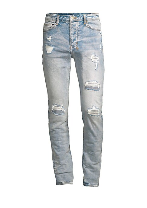 Image of The Chitch jean is a contemporary style jean in a tapered leg, constructed in premium stretch denim. In a mid rise, it features branded hardware, five pockets, and Ksubi cross embroidery at the reverse. Five-pocket style. Button fly. Distressed detail. Co