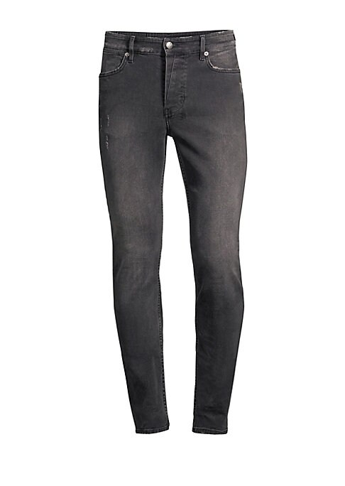 Image of The Van Winkle jeans features a shorter rise, and fits skinny from thigh to ankle. These jeans are in premium comfort stretch denim with sporadic trashing across the front, and feature five pockets, anti-patch detail at the back, and Ksubi cross embroider