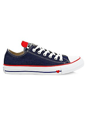 Image of A charming heart peeks out from the vamp of these low-top denim sneakers. Cotton upper Cap toe Lace-up vamp Canvas lining Ortholite insole Rubber sole Imported. Women's Shoes - Sneakers. Converse. Color: Blue. Size: 4.5.