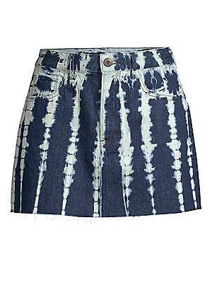 """Image of From the Saks It List: The Mini Skirt The faded shibori print merges with a raw hem for an edgy and deconstructed denim skirt. Belt loops Five-pocket style Zip fly with button closure Cotton Machine wash Made in USA SIZE & FIT A-line silhouette About 15"""""""