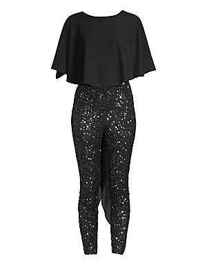 Image of Bring a touch of glam to your evening with this deep V-back jumpsuit featuring eye-catching sequins. Roundneck Three-quarter cape sleeves Deep V-back Concealed back zip closure Polyester Contrast: Nylon Machine wash Imported SIZE & FIT Draped silhouette A