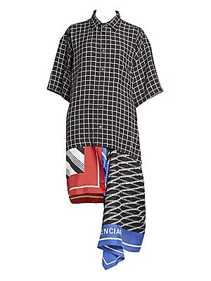 Image of A black-and-white graphic check is spliced into dueling scarf prints on this eyecatching silk-blend shirtdress. Wear as a dress, or team with culottes to enhance the asymmetric high-low hemline. Point collar Elbow-length sleeves Button front Dropped shoul