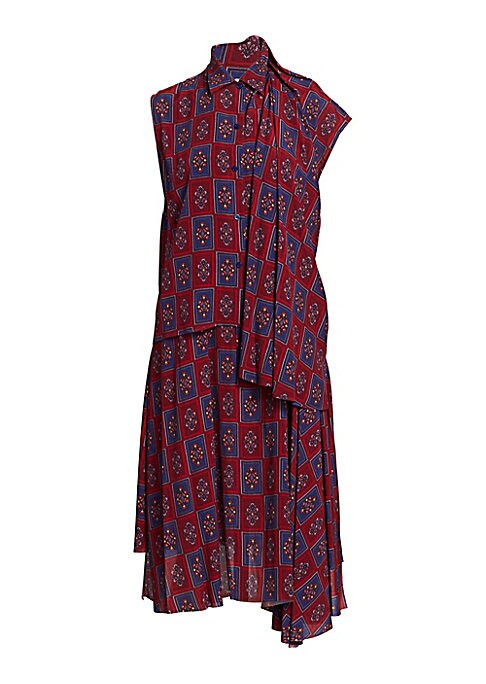 Image of This two-piece tile print garment comprises a midi-length dress partnered with a voluminous button-down over-shirt. With both elements worn together, an avant-garde silhouette is created. Point collar. One cap sleeve. Button front. Asymmetric raw hem. Vis