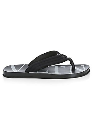 Image of Subtle matte studs top quilted logo flip flops. Polyamide/elastane upper Open toe Slip-on style Molded leather sole Made in Italy. Men's Shoes - Designer Shoes. Valentino Garavani. Color: Black. Size: 41.5 (8.5).