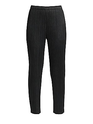 Image of A staple for the modern woman, these easy-care trousers are finished with the brand's signature garment pleated construction. Their slimming tapered leg and cropped length make them ideal for pairing with a statement shoe for a bold look. Elasticized wais