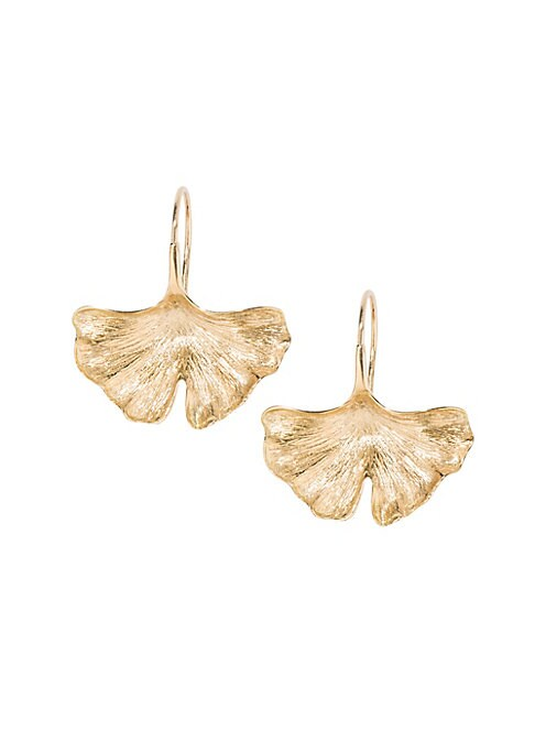 "Image of Bold gingko leaf earrings lend a striking golden finish.18K yellow gold. Fishhook back. Made in France. SIZE. Width, 0.84"".Length, 1.09""."