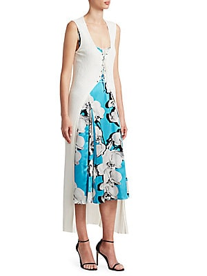 Image of This sleeveless midi dress pops with a fresh floral print and is finished with a unique lace-up cardigan that drapes the silhouette. Scoopneck Sleeveless Lace-up placket Viscose/polyester Silk lining Dry clean Made in Italy Cardigan is not removable SIZE