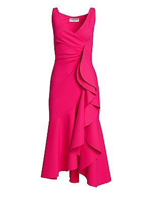 """Image of A beautiful constructed sleeveless dress featuring eye-catching oversized ruffle trim. V-neck Sleeveless Pullover style Wrap construction Large ruffle trim Asymmetric hem Polyamide/elastane Hand wash Made in Italy SIZE & FIT Fitted About 43"""" from shoulder"""
