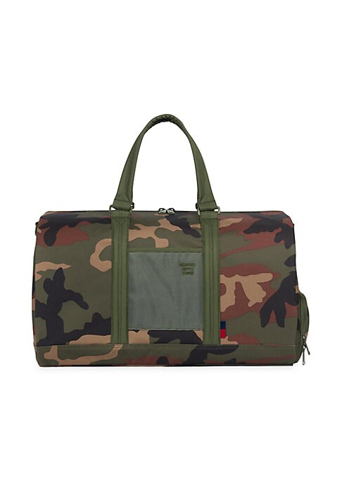 Image of From the Studio Collection. The Studio Novel duffel is a signature carryall design elevated by contemporary finishes. Smooth polycoat and tactile contrast fabrics complement this progressive style, which includes a shoe compartment, identification slot an