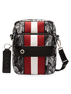 Image of Abstract graphics merge with colorblocking stripes to produce an eclectic crossbody piece. Adjustable, removable crossbody strap Top zip around closure Silvertone hardware One exterior front zip pocket One exterior front strap detail Nylon Imported SIZE 6