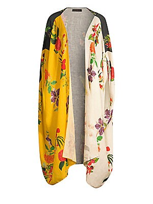 """Image of From the Saks It List: Garden Party Florals Lightweight linen cape silhouette in a vibrant colorblocked floral design makes a dramatic topper. Cape sleeves Open front High-low hem Linen Hand wash Imported SIZE & FIT About 43"""" from shoulder to hem Model sh"""