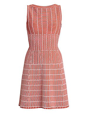 Image of Azzedine Alaïa stretch knit dress features an intricate three-dimensional pattern that looks sculptured while also comfortable to wear. Flattering boatneck, cutout back and a corset-inspired nipped-in waist completes the striking feminine silhouette. Boat