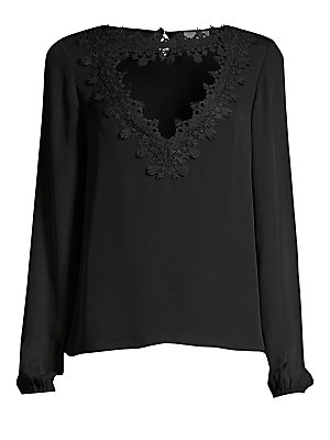 "Image of A triangular cutout at the neckline is framed with intricate silk lace for a dramatic silhouette. Roundneck with cutout Long sleeves Elasticized cuffs Back keyhole button closure Silk Dry clean Imported SIZE & FIT About 24"" from shoulder to hem Model show"