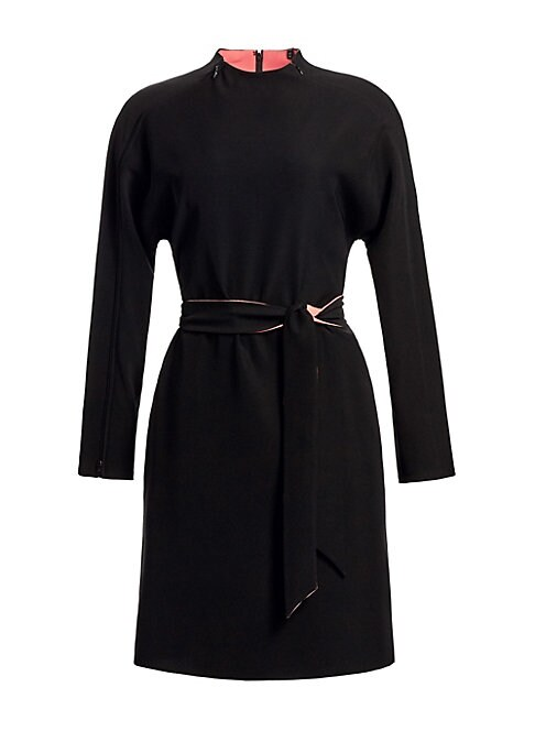 Image of Emporio Armani's long sleeve black dress boasts a minimalist silhouette highlighting impeccable tailoring and bold pink lining. Unzip at the collar or cuffs to play up the contrast coloration. Self-tie belt cinches in the waist. High neck with zippers. Lo
