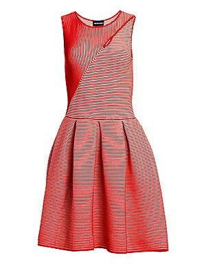 Image of Vertical stripes switch direction abruptly on the bodice of this dress, creating a hypnotic effect. The full skirt of the fit-and-flare silhouette is further enhanced by wide pleats. Roundneck with cutout Sleeveless Pullover style Pleated skirt Viscose/po