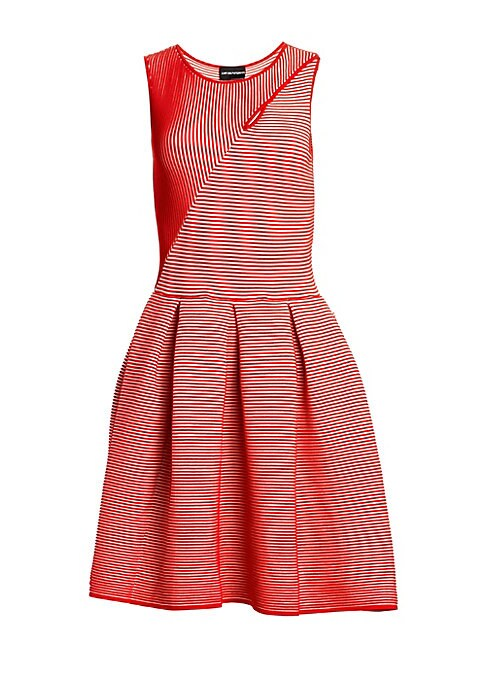 Image of Vertical stripes switch direction abruptly on the bodice of this dress, creating a hypnotic effect. The full skirt of the fit-and-flare silhouette is further enhanced by wide pleats. Roundneck with cutout. Sleeveless. Pullover style. Pleated skirt. Viscos