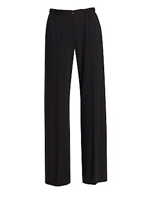 Image of Living somewhere between the track pant and pants of the business variety, these trousers feature an elasticized waistband and crisp pleats. A stretch crepe construction lends the garment a fluidity. Elasticized waistband Zip fly with button closure Lined