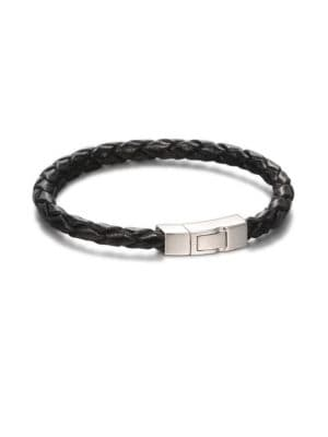 Image of A band of braided Italian leather is joined together with a luminous click clasp of sterling silver. Leather. Rhodium-plated sterling silver. Click clasp. Made in United Kingdom.