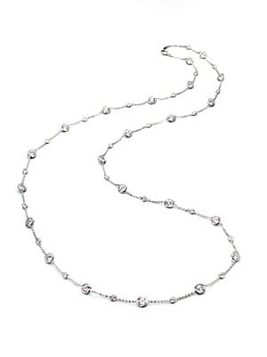 """Image of ONLY AT SAKS. A delicate rhodium-plated chain is sprinkled all along with faceted bezel-set cubic zirconia stations of different sizes. Cubic zirconia Rhodium plated Lobster clasp Imported SIZE Length, about 42.25"""". Fashion Jewelry - Adriana Orsini. Adria"""
