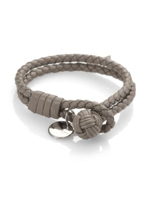 """Image of A double-strand bracelet of supple, braided leather, securing with soutache-knot closure and displaying a signature charm disc in sleek silvertone. Silvertone brass. Leather. Small length, about 7.5"""".Medium length, about 9"""".Knot-and-loop closure. Made in"""