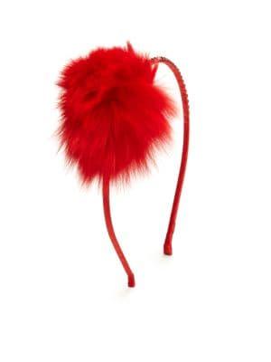 Image of .A fluffy, furry pom-pom atop a slender headband. Satin-wrapped band. Beaded embellishment. Fur pom-pom. Fur type: Dyed fox. Fur origin: China.