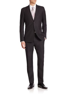 Image of This expertly tailored suit in lightweight Italian wool is enhanced with a modern, slim silhouette. Dry clean. Made in Italy. JACKET. Notch lapel. Button front. Chest welt pocket. Waist flap pockets. Long sleeves. Buttoned cuffs. Dual back vents. Fully li