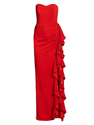 "Image of A gorgeous, cascading side ruffle makes a dramatic, glamorous statement Strapless Princess seams Gathered hip detail Ruffle-trimmed side slit Fully lined About 48"" from natural waist to hem Back zip closure Polyester/spandex Dry clean Imported Model shown"